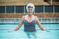 Portrait of senior woman swimming in pool Royalty Free Stock Images