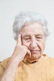 Portrait of senior woman thinking Royalty Free Stock Photos
