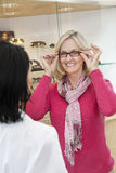 Portrait of a senior woman trying on glasses in store Stock Photo