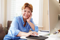Portrait Of Senior Woman Using Computer At Home Royalty Free Stock Photos