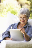 Portrait Of Senior Woman Using Digital Tablet At Home Royalty Free Stock Photos