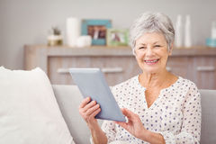 Portrait of senior woman using digital tablet Royalty Free Stock Image