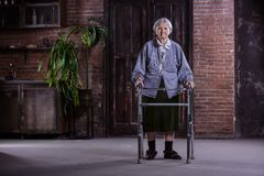 Portrait of senior woman with walker at home royalty free stock photos