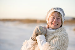 Portrait of senior woman in warm winter clothing royalty free stock image