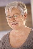 Portrait of senior woman wearing glasses Stock Images