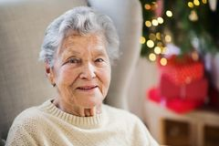 A portrait of a senior woman in wheelchair at home at Christmas time. stock photography
