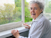 Portrait of senior woman at the window Royalty Free Stock Image