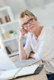 Portrait of senior woman working on laptop Royalty Free Stock Image