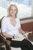 Portrait of a Senior woman Write on Book Stock Photography