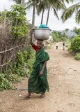 Women portrait, India. Portrait of a senior women carrying a basket of washed clothes, in the remote village of Anchetty, Tamil Nadu, India. Photo taken on 10 royalty free stock image
