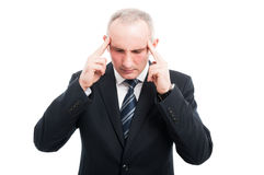 Portrait of senior worker focusing with hands on head. Wearing suit isolated on white background Royalty Free Stock Images