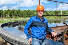 Portrait of senior workman in uniform on industrial plant. Portrait of senior workman in blue uniform on industrial plant Royalty Free Stock Photography