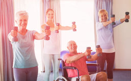 Portrait of seniors exercising with weights Stock Photography