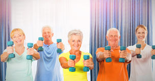 Portrait of seniors exercising with weights stock photo