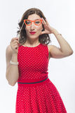 Portrait of Sensual Alluring Caucasian Brunette Girl  Holding Ar. Tistic Spectacles In Front Of Face.Against White Background. Vertical Image Royalty Free Stock Images
