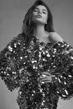 Sensual beautiful brunette woman in a shiny fashion dress of seq Royalty Free Stock Image