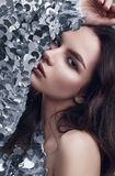 Sensual beautiful brunette woman in a shiny fashion dress of sequins Stock Photography