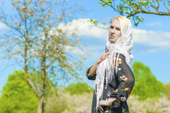 Portrait of Sensual Blond Caucasian Woman in Kerchief Standing I Royalty Free Stock Photo