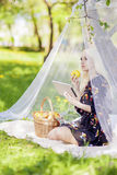 Portrait of Sensual Blond Female Woman Reading Ebook Tablet in F Royalty Free Stock Photography