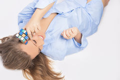 Portrait of Sensual Blond Woman Playing With Cube Stock Photography