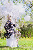 Portrait of Sensual Blond Woman Relaxing on Seesaw in Spring For Royalty Free Stock Photo