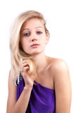 Portrait of sensual blonde woman in purple dress. Portrait of sensual blonde woman in a purple dress on white background royalty free stock photo