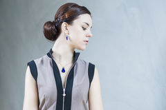 Portrait of Sensual Brunette Female with Blue  Pendent and Earring Stock Photography