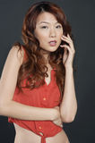 Portrait of sensual Chinese woman over colored background Royalty Free Stock Image