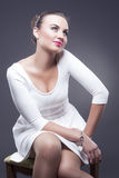 Portrait of Sensual Fashion Caucasian Woman in Sexy Look. Posing Against Gray Background Royalty Free Stock Photos