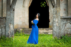 Portrait Of Sensual Fashion Woman In Blue Dress. Portrait Of Sensual Fashion Woman In long Blue Dress in church ruins Stock Photos
