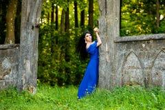 Portrait Of Sensual Fashion Woman In Blue Dress Outdoor. Portrait of sensual fashion young woman in blue dress outdoor Stock Photography