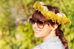 portrait of a sensual girl with flowers on her head Royalty Free Stock Photos