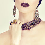 Portrait of a sensual girl in jewelry royalty free stock image