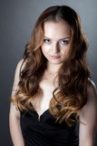 Portrait of sensual gray-eyed girl in black dress Royalty Free Stock Image