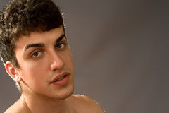 Portrait of sensual handsome young man. Portrait of sensual young man with full lips Stock Photos