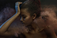 Portrait of a sensual lady among dark dust Stock Images