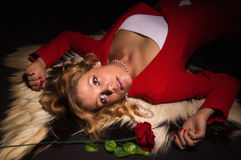Portrait of sensual lady in red with rose Royalty Free Stock Image
