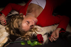Portrait of sensual lady in red with rose Royalty Free Stock Photos