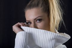 Portrait of sensual positive beautiful blond woman in sweater Royalty Free Stock Photos