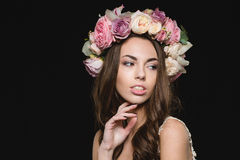 Portrait of sensual seductive young female in flower wreath Royalty Free Stock Photo