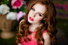 Portrait of a sensual sexy redheaded girls on floral background.  Stock Photo