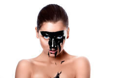 Portrait of sensual woman with black paint on face Royalty Free Stock Photos