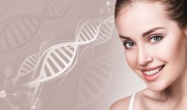 Portrait of sensual woman in DNA chains. Over beige background stock photography