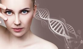 Portrait of sensual woman in DNA chains. Stock Photos
