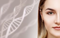 Portrait of sensual woman among DNA chains. Over beige background royalty free stock photos