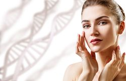 Portrait of sensual woman among DNA chains. Over white background stock images