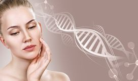Portrait of sensual woman in DNA chains. Over beige background royalty free stock photos