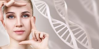 Portrait of sensual woman among DNA chains. Over beige background stock photography