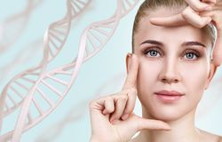 Portrait of sensual woman among DNA chains. Over blue background royalty free stock photography