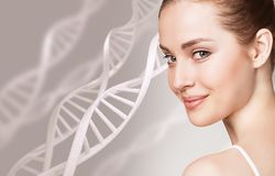 Portrait of sensual woman among DNA chains. Young sensual woman among DNA chains over gray background. Biochemistry skin concept royalty free stock photos